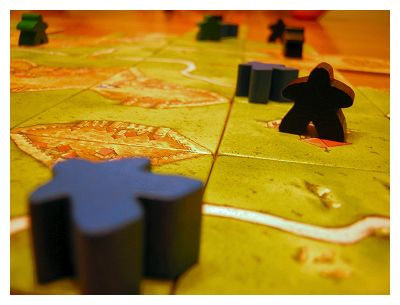 This is a game called Carcassonne.  We played two games with a couple of friends tonight who'd never seen it.  Each of them won one game each.  Freakin' beginner's luck...
