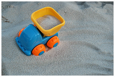 One of the many, many toys in Coleman's new sand box...